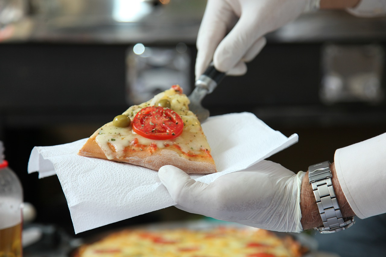 serving a piece of pizza
